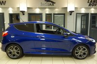 USED 2017 67 FORD FIESTA 1.0 ST-LINE X 3d 99 BHP FINISHED IN STUUNING SPIRIT BLUE WITH HALF BLACK LEATHER SEATS + SATELLITE NAVIGATION + APPLE CAR PLAY + ANDRIOD MUSIC INTERFACE + LED DAY TIME RUNNING LIGHTS + LANE ASSIST + PARK ASSSIT + HEATED WINDSCREEN + ADAPTIVE HEADLIGHTS + RAIN SENSORS + VOICE COMMAND + WIFI CONNECTIVITY + FOLDING MIRRORS + CRUISE CONTROL + BLUETOOTH + DAB DIGITAL RADIO + DUAL ZONE AIR CONDITIONING + CLIMATE CONTROL + ULEZ COMPLIANT
