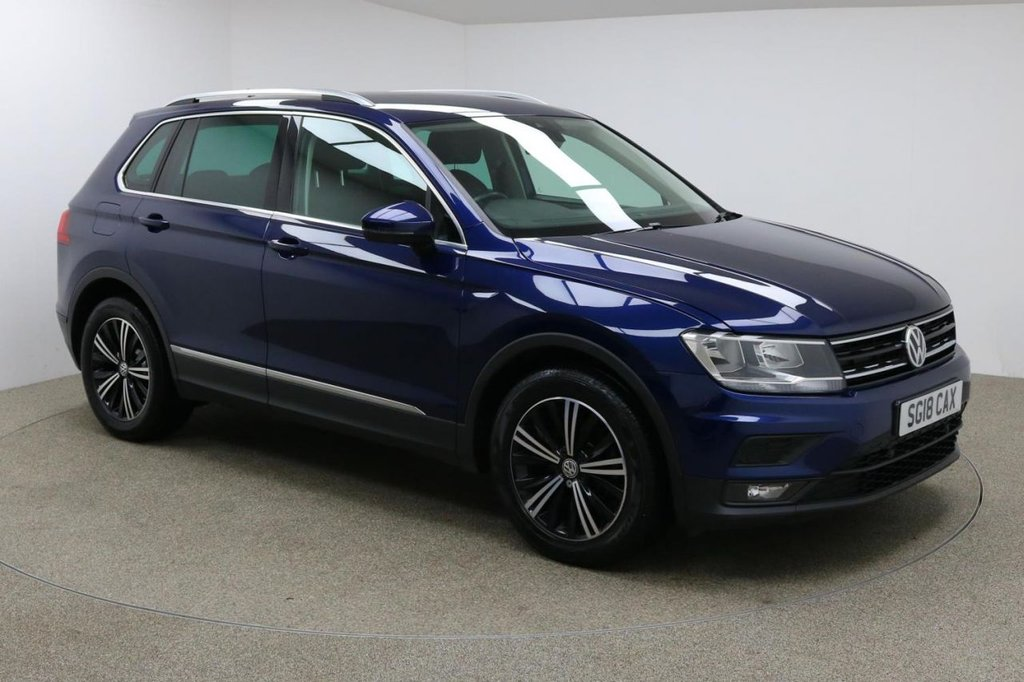 USED 2018 18 VOLKSWAGEN TIGUAN 2.0 SE NAV TDI BMT 5d 148 BHP Finished in stunning metallic Atlantic Blue + 18 inch diamond cut alloys + black cloth interior + Bluetooth + DAB Radio + In car entertainment - CD / AUX / USB / SD + Auto start / stop + Air con + Dual climate control + Cruise control + Electric Folding / Heated Mirrors + Electric windows + Electric powered boot + Lane assist + Auto lights + ULEZ EXEMPT