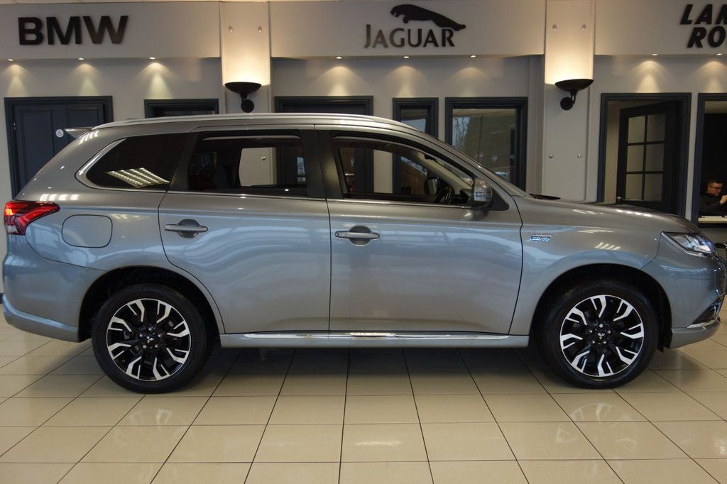 USED 2016 16 MITSUBISHI OUTLANDER 2.0 PHEV GX 5HS 5d 161 BHP FINISHED IN STUNNING METALLIC ATLANTIC GREY WITH FULL RED LEATHER ELECTRIC ADJUSTING HEATED SEATS WITH MEMORY PACKAGE + TOUCH SCREN SATELLITE NAVIGATION + REAR CAMERA 360 + HEATED FOLDING MIRRORS + HEATED STEERING WHEEL + LANE ASSIST + COLLISION WARNING + 4WD LOCK + HYBRID + ELECTRIC TAILGATE + HEATED REAR SEATS + PADDLE SHIFT GEARS + PANORMAIC SLIDING ROOF + ALPINE SOUND SYSTEM + GLOSS BLACK TRIM + AMBIENT LIGHTING + REAR 12V SOCKET + 60/40 FOLDING REAR SEATS + 18 INCH DIAMOND CUT ALLOY WHEELS