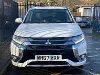 USED 2017 67 MITSUBISHI OUTLANDER 2.0 PHEV 4H 5d 200 BHP STUNNING WHITE PEARL PAINTWORK WITH FULL BLACK LEATHER UPHOLSTERY. FULL MITSUBISHI SERVICE HISTORY. GLASS ELECTRIC SUNROOF. SATELLITE NAVIGATION. 360 CAMERA. HEATED SEATS. ELECTRIC SEATS. HEATED STEERING WHEEL. DAB RADIO SYSTEM. DIAMOND CUT ALLOY WHEELS. AIR CONDITIONING. ELECTRIC WINDOWS. REMOTE CENTRAL LOCKING WITH TWO KEYS. PLEASE GOTO www.lowcostmotorcompany.co.uk TO VIEW OVER 120 CARS IN STOCK