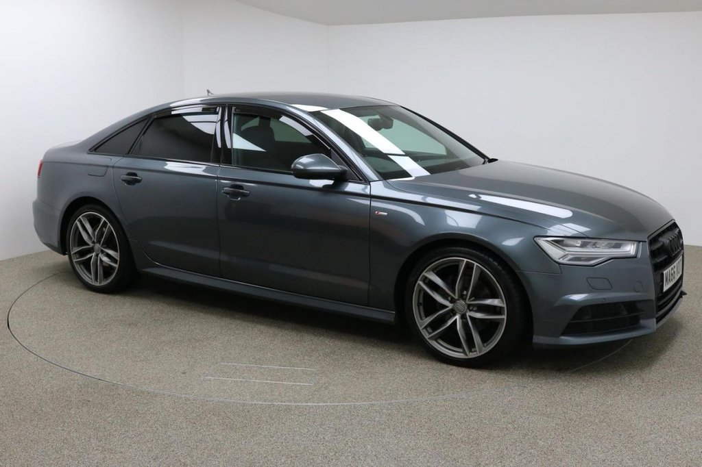 USED 2016 66 AUDI A6 2.0 TDI ULTRA BLACK EDITION 4d 188 BHP Finished in stunning pearl Daytona Grey + 20 inch alloys + full black leather interior + Sat nav + Electric Heated Memory seats + Bluetooth + DAB Radio + In car entertainment - CD / SD / AMI + Start / stop + Air con + Dual climate control + Multi function steering wheel + Cruise control + Electric heated / folding mirrors + Electric windows + BOSE Audio system + Front / Rear parking sensors + Auto lights + Voice control + ULEZ Exempt