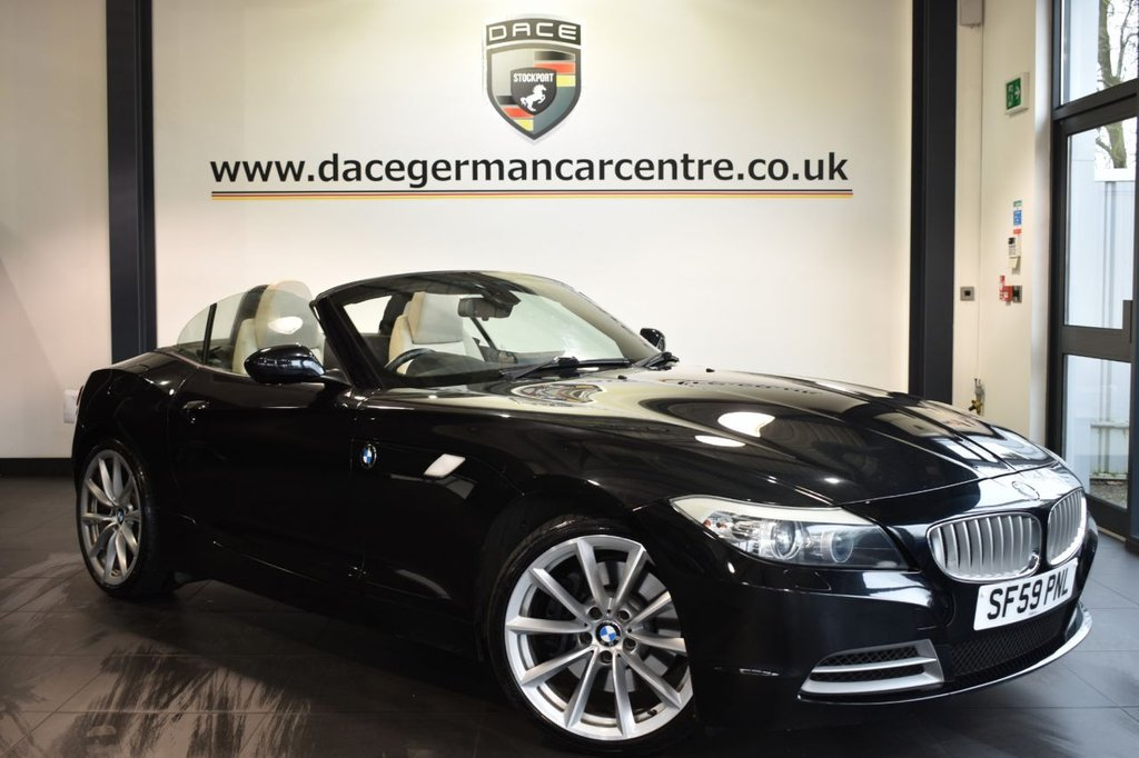 "USED 2009 59 BMW Z4 3.0 Z4 SDRIVE35I ROADSTER 2DR AUTO 302 BHP Finished in a stunning sapphire metallic black styled with 19"" alloys. Upon opening the drivers door you are presented with full cream leather interior, full service history, pro satellite navigation, bluetooth, heated sport seats with memory, cruise control, DAB radio, Multifunction steering wheel, Interior/outside mirror with auto dip, Headlight cleaning system, Automatic air conditioning, rain sensors, light package, High-beam assistant"