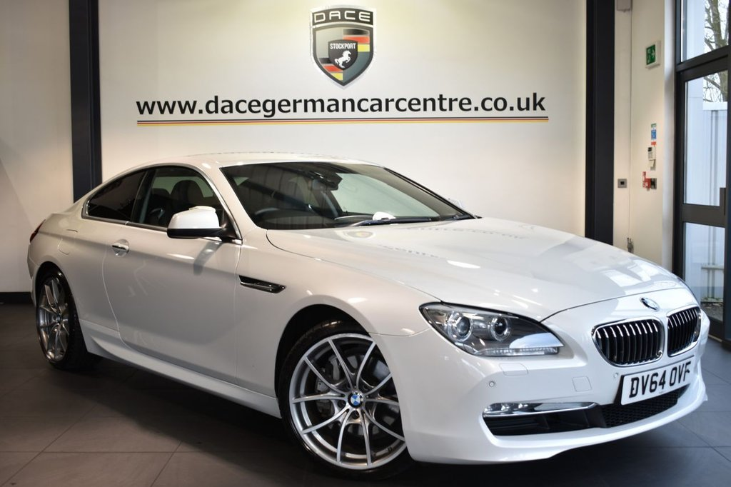 "USED 2014 64 BMW 6 SERIES 3.0 640D SE 2d AUTO 309 BHP Finished in a stunning mineral metallic white styled with 20"" alloys. Upon opening the drivers door you are presented with full black leather interior, full service history, pro satellite navigation, bluetooth, heated seats, DAB radio, cruise control, Interior/outside mirror with auto dip, Ambient interior lighting, LED Fog lights, Connected Drive Services, Auto start/stop function, parking sensors"