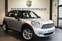 """USED 2013 63 MINI COUNTRYMAN 2.0 COOPER D 5DR AUTO 110 BHP Finished in a stunning crystal metallic silver styled with 17"""" alloys. Upon opening the drivers door you are presented with half leather interior, superb service history, bluetooth, DAB radio, sport seats, Multifunction steering wheel,  Sport button, Automatic air conditioning, Rain sensors, front/rear fog lights, Radio MINI Boost CD, parking sensors"""