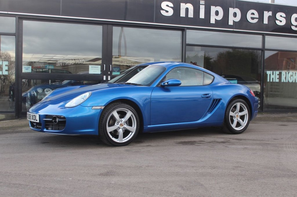 USED 2008 08 PORSCHE CAYMAN 2.7 24V 2d 242 BHP Presented in Colbalt blue metallic with full black leather upholstery Sound package plus with CD storage, Park assist (rear), Automatic Climate Control, Seat heating, 18-inch Boxster S wheels & 3-spoke sports steering wheel in leather. This Porsche Cayman 2.7 is offered in fantastic condition throughout and boasts a full service history, 2 Keys and Book Pack.