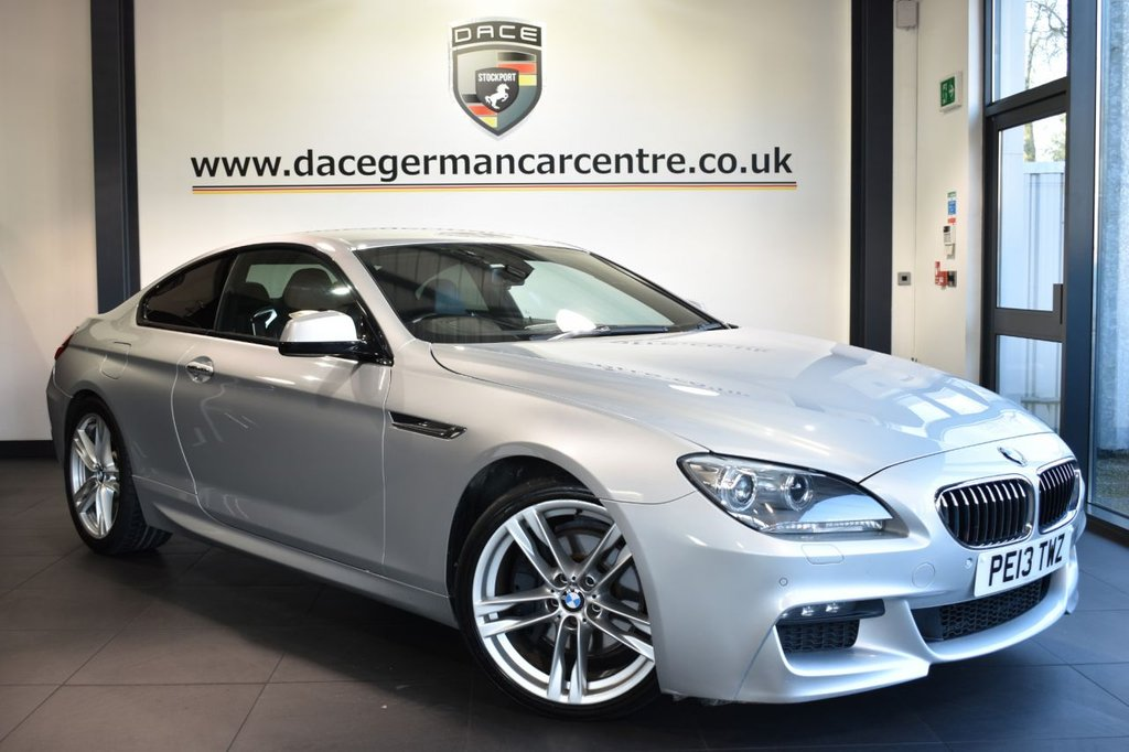 """USED 2013 13 BMW 6 SERIES 3.0 640D M SPORT 2DR AUTO 309 BHP Finished in a stunning titan silver styled with 20"""" alloys. Upon opening the drivers door you are presented with  full black leather interior, superb service history, pro satellite navigation, bluetooth, head-up display, , LED Fog lights, DAB radio, Driving experience switch incl. ECO PRO, Soft-Close-Automatic doors, parking sensors, ULEZ EXEMPT."""