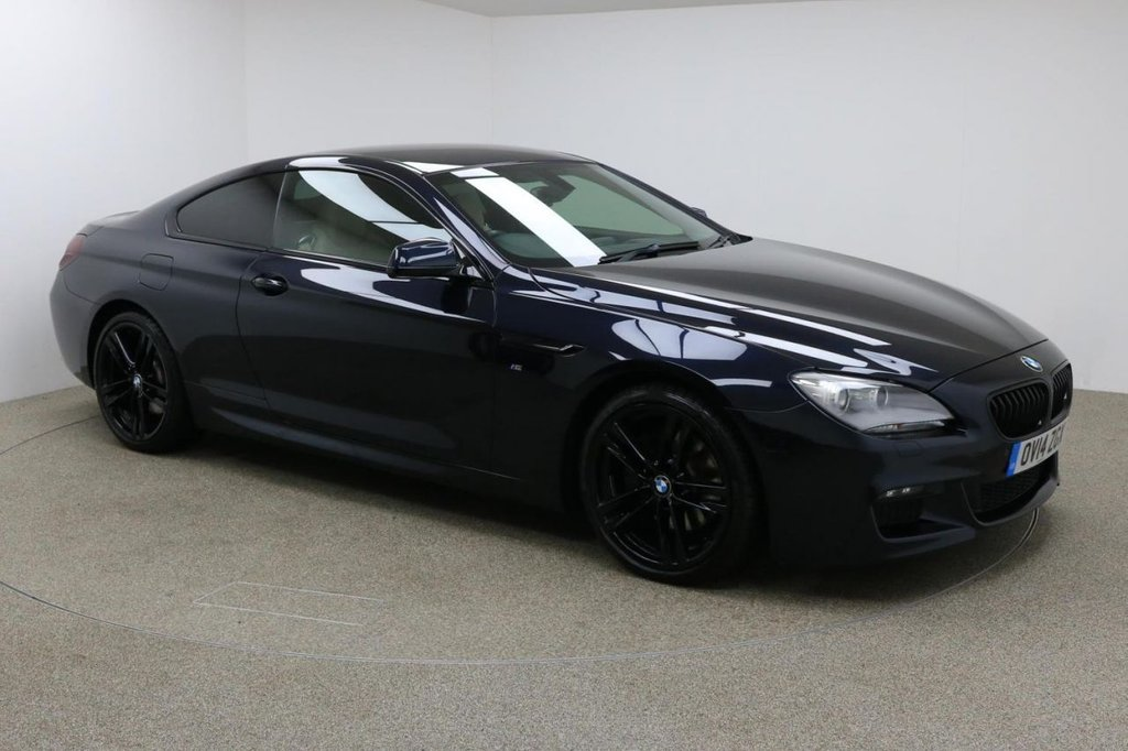 USED 2014 14 BMW 6 SERIES 3.0 640D M SPORT 2d AUTO 309 BHP Finished in stunning Carbon Black + 20 inch alloys + Full Cream leather + Sat nav + Bluetooth + DAB radio + Full Service history + In car entertainment - CD / AUX / USB + Cruise control + Privacy Glass + Front / Rear Parking sensors + Rear reverse camera + Xenon headlights + Rear reverse camera + Auto Start / Stop + Air con + Dual Climate control + Multi Function steering wheel + Electric folding mirrors + Electric Windows + Auto lights / wipers + Electric Heated Memory seats + ULEZ EXEMPT