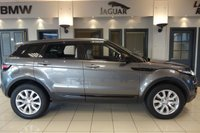 USED 2015 65 LAND ROVER RANGE ROVER EVOQUE 2.0 TD4 SE TECH 5d 177 BHP FINISHED IN STUNNING METALLIC CORRIS GREY WITH FULL BLACK LEATHER HEATED SEATS WITH MEMORY PACK + SATELLITE NAVIGATION + HEADS UP DISPLAY + DAB DIGITAL RADIO + BLUETOOTH MUSIC INTERFACE + LANE KEEP ASSIST + MERIDIAN SOUND SYSTEM + POWER FOLDING MIRRORS + VOICE COMMAND + DAY TIME RUNNING LIGHTS + RAIN SENSORS + ELECTRIC RAILGATE + CLIMATE CONTROL + DUAL ZONE AIR CONDITIONING + CRUISE CONTROL + AUTO LIGHTS + HEATED SEATS + ULEZ COMPLIANT