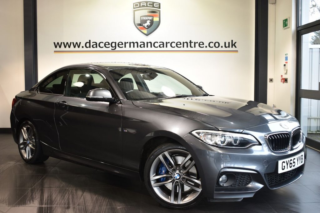 "USED 2015 65 BMW 2 SERIES 1.5 218I M SPORT 2DR 134 BHP Finished in a stunning mineral metallic grey styled with 18"" alloys. Upon opening the drivers door you are presented with anthracite upholstery, full service history, satellite navigation, bluetooth, harman/kardon surround sound system, DAB radio, xenon lights, sport seats, Headlight cleaning system, rain sensors, Multifunction steering wheel, parking sensors, ULEZ EXEMPT."