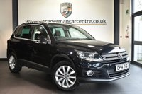 "USED 2014 14 VOLKSWAGEN TIGUAN 2.0 MATCH TDI BLUEMOTION TECHNOLOGY 4MOTION 5DR 139 BHP Finished in a stunning black styled with 17"" alloys. Upon opening the drivers door you are presented with cloth upholstery, full service history, satellite navigation, bluetooth, DAB radio, park assist, multi functional steering wheel, heated mirrors, auxiliary port, parking sensors"