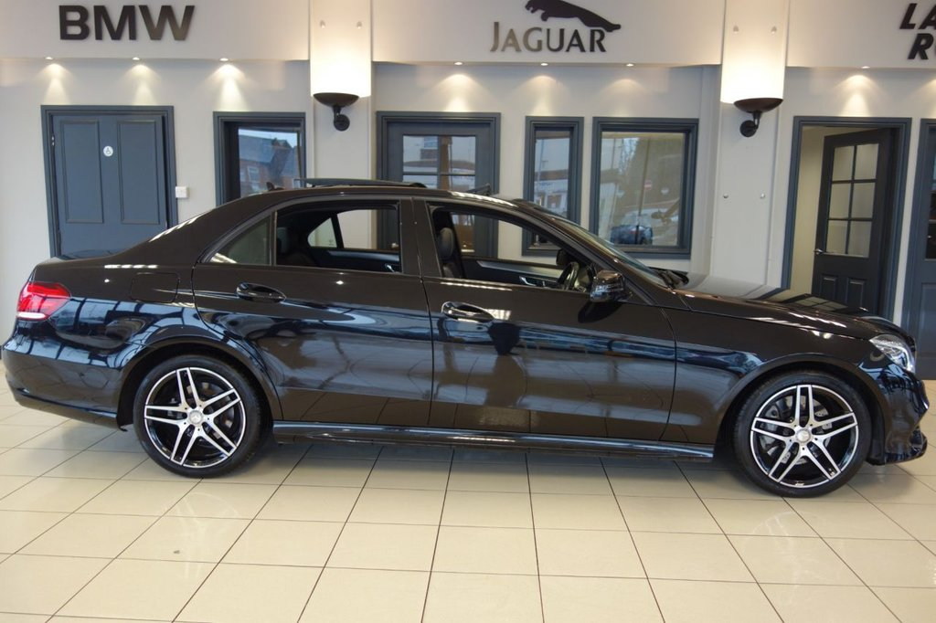 USED 2015 65 MERCEDES-BENZ E CLASS 3.0 E350 BLUETEC AMG NIGHT EDITION PREMIUM 4d AUTO 255 BHP FINISHED IN STUNNING METALLIC OBSIDIAN BLACK WITH FULL BLACK NAPPA LEATHER HEATED SEATS WITH MEMORY PACKAGE + SATELLITE NAVIGATION + 1OWNER FROM NEW WITH AN IMPECCABLE FULL MERCEDES MAIN DEALER SERVICE HISTORY + BLUETOOTH PHONE AND BLUETOOTH MEDIA + DAB DIGITAL RADIO + REAR-VIEW CAMERA + ACTIVE PARK ASSIST + INTERIOR AND EXTERIOR MIRROR,AUTOMATICALLY DIMMING + COLLISON WANRING + PANORAMIC SLIDING SUNROOF + 9-SPEED AUTOMATIC TRANSMISSION + ELECTRIC FOLDING MIRRORS + AUTOMATIC HIGH BEAM SWITCH PLU