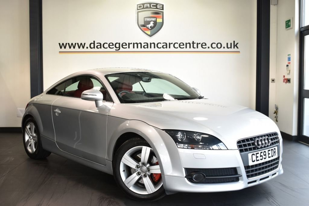 USED 2009 59 AUDI TT 2.0 TFSI 3DR 200 BHP Finished in a stunning ice metallic silver styled with alloys. Upon opening the drivers door you are presented with full red leather interior, full service history, bluetooth, xenon lights, heated mirrors, auxiliary port, parking sensors, ULEZ EXEMPT