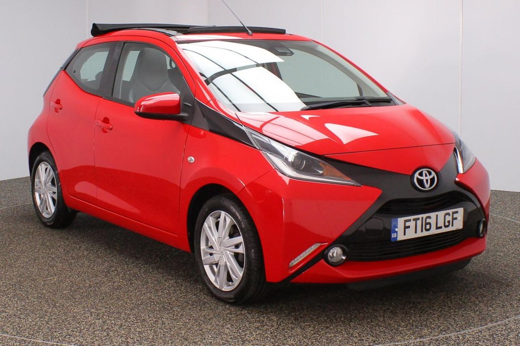 USED 2016 16 TOYOTA AYGO 1.0 VVT-I X-PRESSION TSS 5DR SAT NAV 1 OWNER 69 BHP  SERVICE HISTORY + FREE 12 MONTHS ROAD TAX + HALF LEATHER SEATS + OPEN AIR / SUN ROOF + SATELLITE NAVIGATION + REVERSE CAMERA + BLUETOOTH + CRUISE CONTROL + MULTI FUNCTION WHEEL + AIR CONDITIONIG + LANE ASSIST SYSTEM + DAB RADIO + ELECTRIC WINDOWS + RADIO/AUX/USB + ELECTRIC/HEATED DOOR MIRRORS + 15 INCH ALLOY WHEELS