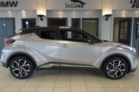 """USED 2017 17 TOYOTA CHR 1.8 DYNAMIC 5d AUTO 122 BHP FINISHED IN STUNNING METALLIC SILVER WITH BLACK/BLUE CONSTRASTING HEATED CLOTH SEATS WITH ELECTRIC ADJUSTMENT + SATELLITE NAVIGATION + DAB DIGITAL RADIO + IPOD CONNECTION + WIFI + APP CONNECT + ENERGY MONITOR + ACTIVE PARK ASSIST + AUTO LIGHTS + HYRBID + EV MODE + LANE KEEP ASSIST + COLLISON WARNING ASSIST + VOICE COMMAND + AUTO HOLD + 60/40 REAR FOLDING SEATS + POWER FOLDING HEATED MIRRORS + SATIN BLUE INTERIOR TRIM + 18"""" ALLOY WHEELS + DUAL ZONE AIR CONDITIONING + BLUETOOTH + CLIMATE CONTROL +"""