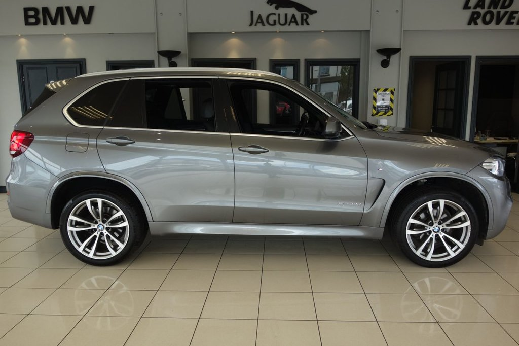 USED 2015 65 BMW X5 3.0 XDRIVE30D M SPORT 5d AUTO 255 BHP FINISHED IN STUNNING METALLIC SPACE GREY WITH FULL BLACK LEATHER HEATED SEATS WITH MEMORY PACKAGE + SATELLITE NAVIGATION + ELECTRIC ADJUSTING STEERING WHEEL + AMBIENT LIGHTING + LANE KEEP ASSIST + DAB DIGITAL RADIO + BLUETOOTH MEDIA + POWER FOLDING MIRRORS + SELECTABLE DRIVING MODES + POWER TAILGATE 50/50 + GLOSS BLACK WITH CHROME INTERIOR TRIM + RAIN SENSORS + 4 ZONE DUAL ZONE AIR CONDITIONING + CLIMATE CONTROL + ADAPTIVE SUSPENSION + PARK DISTANCE CONTROL + XENON HEADLIGHTS + DRIVING ASSISTANC