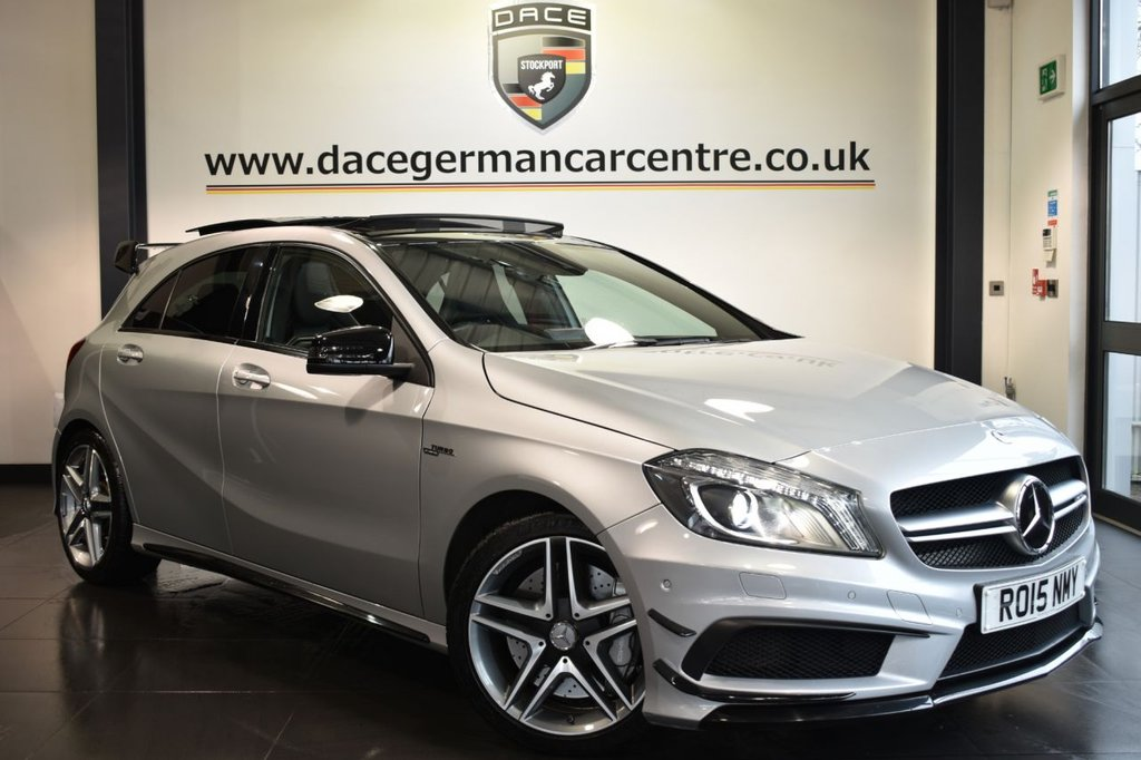 """USED 2015 15 MERCEDES-BENZ A45 2.0 A45 AMG 4MATIC 5DR AUTO 360 BHP Finished in a stunning metallic silver styled with 19"""" alloys. Upon opening the drivers door you are presented with half black leather interior, full service history, comand satellite navigation, panoramic roof, xenon lights, aerodynamic package, bluetooth, recaro sport seats, cruise control, sport seats, climate control, multi functional steering wheel, parking sensors, ULEZ EXEMPT"""
