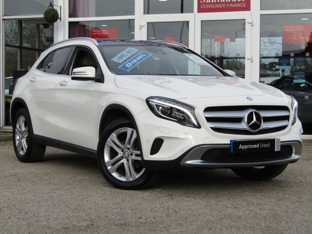 """USED 2015 15 MERCEDES-BENZ GLA-CLASS 2.1 GLA220 CDI 4MATIC SPORT PREMIUM PLUS 5d 168 BHP Finished in CIRRUS WHITE with contrasting Artico SAHARA BEIGE HEATED LEATHER TRIM. This Mercedes GLA is a practical and comfortable SUV crossover with a high quality interior and distinctive styling. Features include, Panoramic Sunroof, Sat Nav, Reversing Camera, 18"""" Alloys, Heated electric memory Leather Seats, Inteligent Lights, Electric tailgate and much more. Dealer serviced at 16030 miles, 30520 miles and at 42652 miles. Comes with 12 months MOT."""