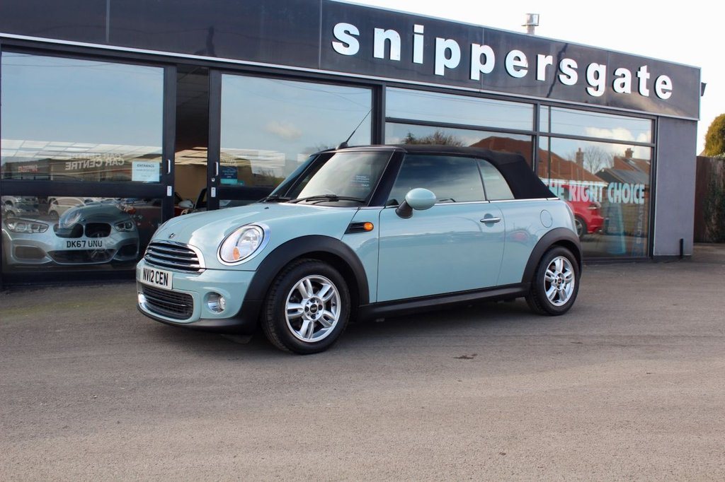 USED 2012 12 MINI CONVERTIBLE 1.6 ONE 2d 98 BHP Ice Blue, Bluetooth Hands Free System, DAB Tuner, Heated Seats, Parking Sensors, Light Package, Onboard Computer, Automatic Air Conditioning, Dynamic Stability Control. Leather Steering Wheel, Pepper Pack, Heated Door Mirrors, 2 Keys and Book Pack, Full Service History.