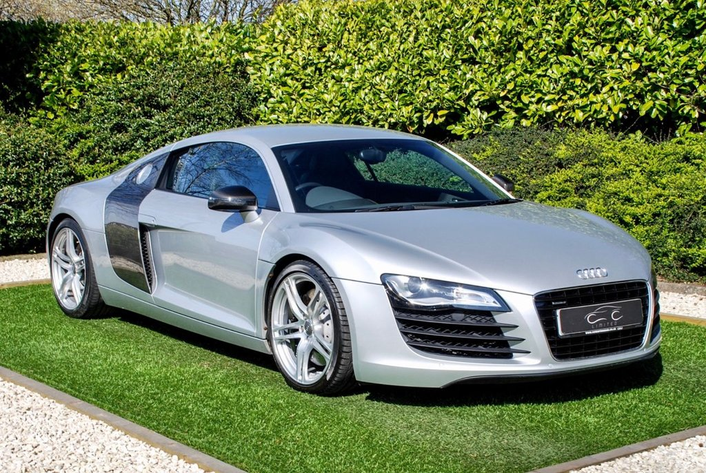 USED 2007 57 AUDI R8 4.2 QUATTRO 2d 420 BHP A Pristine 1 Owner Example in Fantastic Condition with a Huge Spec+Detailed Full Audi Main Dealer History and Large History File Including Purchase Inv oice Service Invoices/MOT's Complete with Huge Specification Immaculately PresIented in Ice Silver Metallic/Black Full Leather Heated Seats DVD Sat Nav Carbon Sigma Side Blades Audi Parking System Advanced+Reverse Camera Heated Electric Mirrors Tyre Pressure Monitor System Leather M/F Steering Wheel The Very Best Avaiable Worthy of any Collection