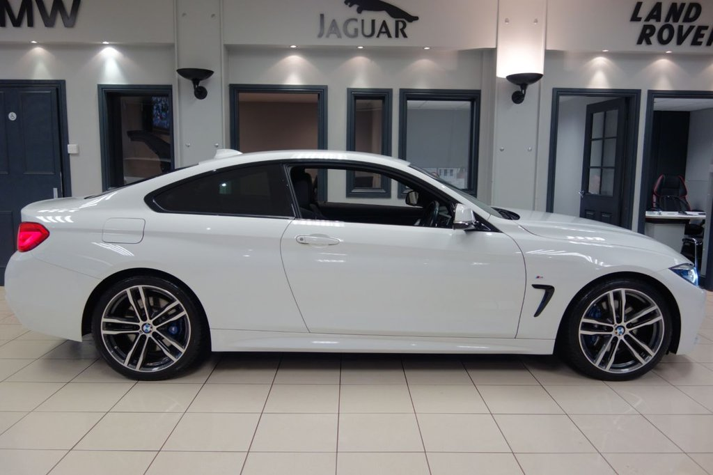 USED 2017 17 BMW 4 SERIES 2.0 420D M SPORT 2d AUTO 188 BHP FINISHED IN STUNNING ALPINE WHITE WITH FULL BLACK LEATHER HEATED SEATS WITH MEMORY PACKAGE + PROFESSIONAL SATELLITE NAVIGATION + DAB DIGITAL RADIO + BLUETOOTH MUSIC INTERFACE + HARMON KARDON SOUND SYSTEM + PRIVACY GLASS + FRONT/REAR PARK ASSIST + HIGH BEAM ASSIST + ADAPTIVE CRUISE + LEATHER WHITE STITCHED DASH + POWER FOLDING MIRRORS + AUTO LIGHTS + VOICE COMMAND + PADDLE SHIFT GEARS + 60/40 REAR FOLDING SEATS + BRUSHED CHROME WITH GLOSS BLACK INTERIOR TRIM + RAIN SENSORS + WIFI CONNECTIVITY + A