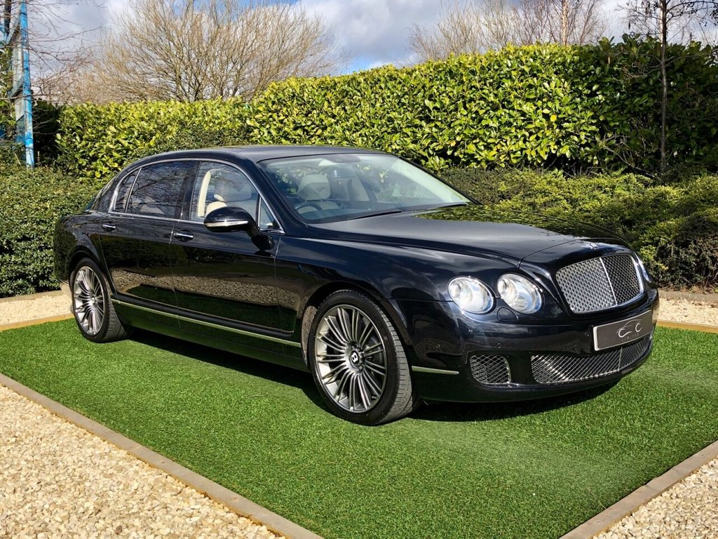 USED 2011 11 BENTLEY CONTINENTAL FLYING SPUR 6.0 FLYING SPUR SPEED 4d 600 BHP An Impeccable Example with a Perfect Bentley Main Dealer Service History. Finished in Metallic Black and Trimmed with Ivory Quilted Mulliner Leather + Contrast Diamond Black Stitch and Bentley Stitched Logo's to all Headrests + Massage Function. Complete with a Fantastic Bentley Specification to Include: Touch Screen Satellite Navigation + Bluetooth Connectivity + DAB Radio, Electric Sunroof, Front and Rear Park Distance Control + Reverse Camera, Soft Close Doors