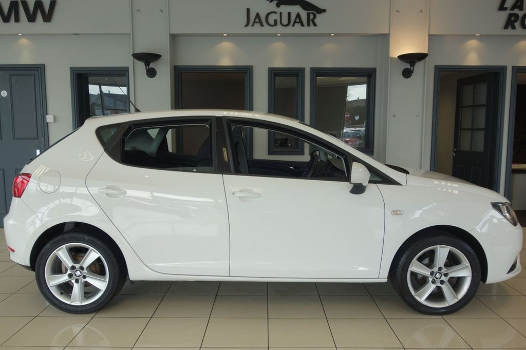 """USED 2014 64 SEAT IBIZA 1.4 TOCA 5d 85 BHP FINISHED IN STUNNING WHITE WITH FULL CLOTH SEATS + GARMIN SATELLITE NAVIGATION + IN CAR ENTERTAINMENT AUX/USB/12V + DAB DIGITAL RADIO + BLUETOOTH MEDIA + AIR CONDITIONING + CLIMATE CONTROL + ELECTRIC MIRRORS + ELECTRIC WINDOWS + 16"""" SILVER ALLOY WHEELS + HEATED ELECTRIC MIRRORS + VOICE COMMAND + VOLUME CONTROL STICK + VERY CLEAN CAR INSIDE AND OUT"""