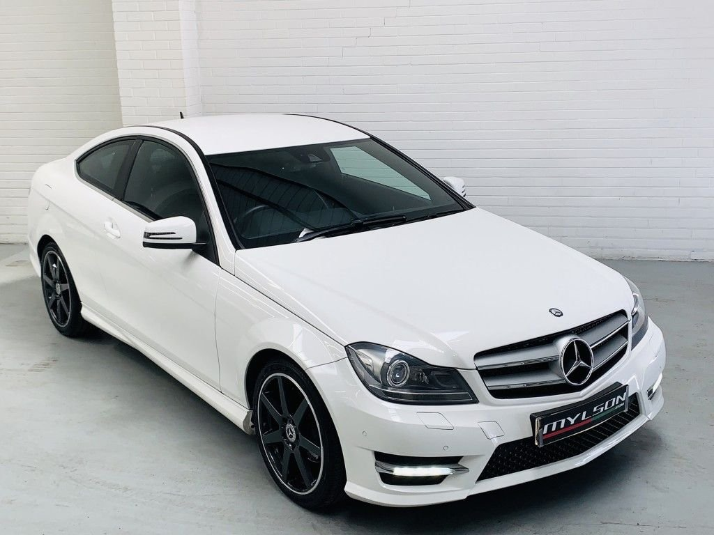 USED 2012 62 MERCEDES-BENZ C-CLASS 2.1 C220 CDI BLUEEFFICIENCY AMG SPORT 2DR AUTOMATIC White with Black Leather, Gloss Black Wheels, AMG Pack, Heated Seats