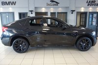 USED 2016 64 BMW X6 3.0 XDRIVE30D M SPORT 4d 255 BHP FINISHED IN STUNNING METALLIC SAPPHIRE BLACK WITH FULL BLACK LEATHER HEATED SEATS WITH MEMORY PACK PLUS LUMBAR SUPPORT + SATELLITE NAVIGATION + DAB DIGITAL RADIO + BLUETOOHT MEDIA + HARMON KARDON SOUND SYSTEM + VOICE COMMAND + 360 VIEW CAMERA + FRONT/REAR PARK ASSIST + ELECTRIC STEERING WHEEL + POWER FOLDING HEATED MIRRORS + AUTO LIGHT WITH LED DAYTIME RUNNING LIGHTS + PADDLE SHIFT GEARS + AMBIENT LIGHTING + SELECTABLE DRIVING MODES + ELECTRIC TAILGATE + BRUSHED CHROME WITH GLOSS BLACK INTERIOR