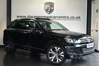 USED 2014 64 VOLKSWAGEN TOUAREG 3.0 V6 R-LINE TDI BLUEMOTION TECHNOLOGY 5DR 242 BHP Finished in a stunning metallic black styled with 20 inch alloys. Upon entry you are presented with full black leather interior, satellite navigation, panoramic sunroof, bluetooth, cruise control, Dynaudio sound system, parking sensors, heated seats, lumbar support, heated steering wheel, drivers side memory seats, steering mounted gear shifters, folding door mirrors, on/off road driving switch, automatic lights