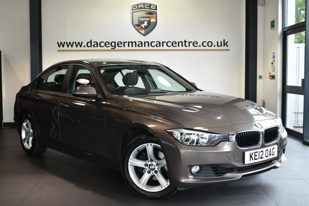 """USED 2012 12 BMW 3 SERIES 2.0 320I SE 4DR AUTO 181 BHP Finished in a stunning sparkling metallic bronze styled with 17"""" alloys. Upon entry you are presented with full black leather interior, full service history, bluetooth, cruise control, parking sensors, heated front seats, BMW teleservices, auto dipping interior mirrors, fog lights, rain sensors, aux/usb media ports, multi function steering wheel"""