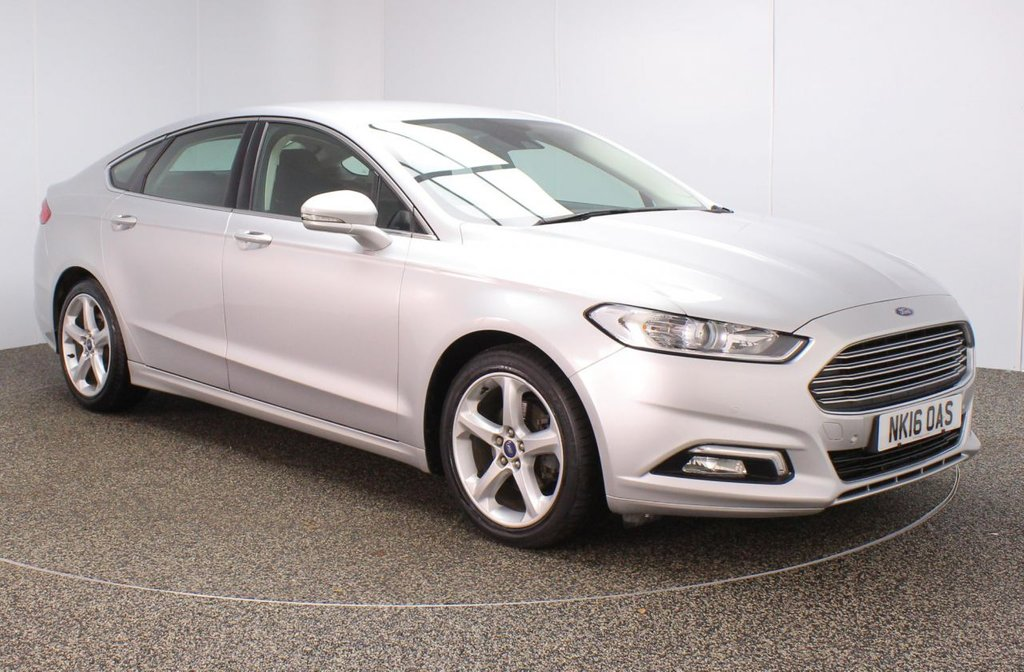 USED 2016 16 FORD MONDEO 2.0 TITANIUM TDCI 5DR 1 OWNER 148 BHP SERVICE HISTORY + £30 12 MONTHS ROAD TAX + SATELLITE NAVIGATION + PARKING SENSOR + BLUETOOTH + CRUISE CONTROL + CLIMATE CONTROL + MULTI FUNCTION WHEEL + LANE ASSIST SYSTEM + DAB RADIO + RADIO/CD/USB + ELECTRIC WINDOWS + ELECTRIC/FOLDING DOOR MIRRORS + 18 INCH ALLOY WHEELS
