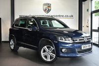 """USED 2014 64 VOLKSWAGEN TIGUAN 2.0 R LINE TDI BLUEMOTION TECH 4MOTION DSG 5d AUTO 175 BHP Finished in a stunning metallic blue styled with 18"""" alloys. Upon opening the drivers door you are presented with cloth upholstery, full service history, bluetooth, cruise control, dab radio, multi functional steering wheel, park assist, heated mirrors, parking sensors"""