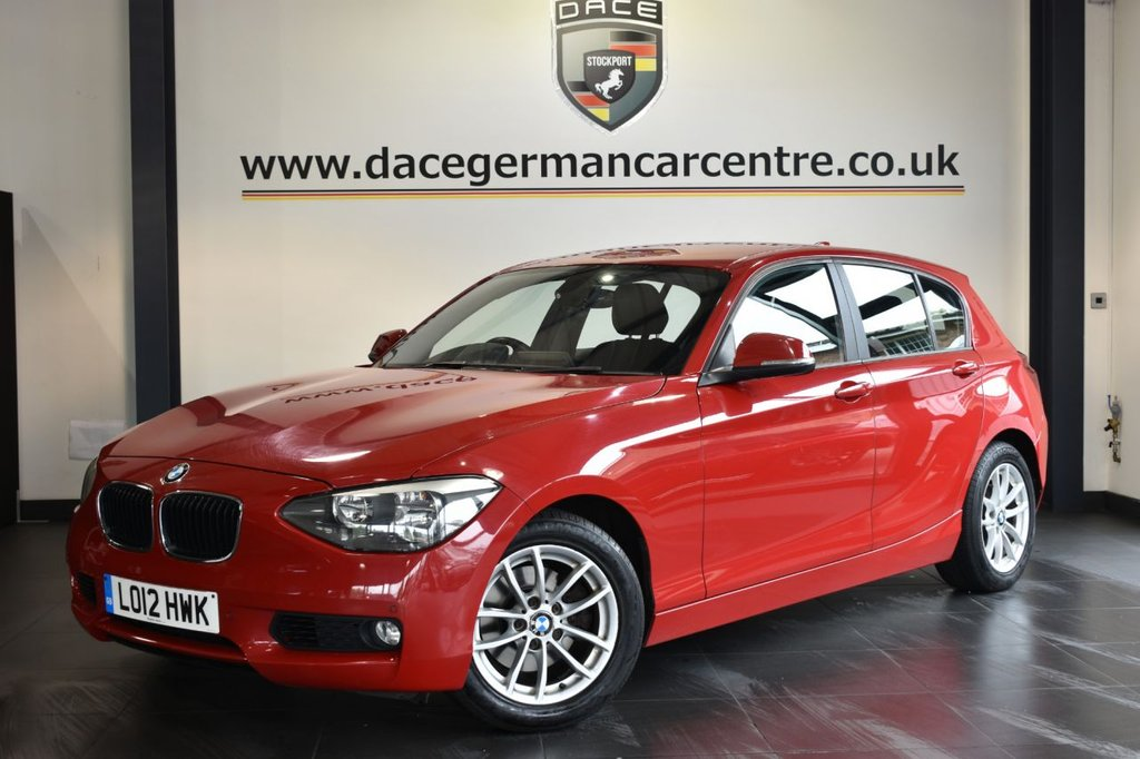"""USED 2012 12 BMW 1 SERIES 2.0 120D SE 5DR AUTO 181 BHP Finished in a stunning crimson red styled with 16"""" alloys. Upon opening the drivers door you are presented with anthracite upholstery, bluetooth, full service history, Multifunction steering wheel, Automatic locking during starting, Fog lights, front armrest, parking sensors"""