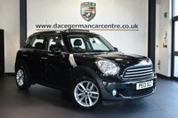 "USED 2013 13 MINI COUNTRYMAN 1.6 COOPER 5DR 122 BHP Finished in a stunning absolute metallic black styled with 17"" alloys. Upon opening the drivers door you are presented with half leather interior, full service history, bluetooth, electric glass roof, heated seats, DAB radio, Automatic air conditioning, Light package, rain sensors, parking sensors"