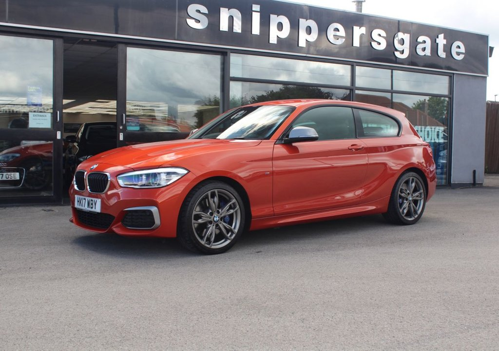 USED 2017 17 BMW 1 SERIES 3.0 M140I 3d 335 BHP Valencia Orange Metallic, 1 Owner From New, Satellite Navigation System, Harman Kardon Music SystemAuto Dim Mirror, DAB Tuner, USB Interface, Cruise Control, Rain Sensor, LED Headlights, Park Distance Control, Heated Seats, Variable Sports Steering, Tyre Pressure Display, Storage Compartment Pack, Retractable Armrest, Sports Seats, 2 Keys and Book Pack, FSH BMW Service History - Just Serviced.