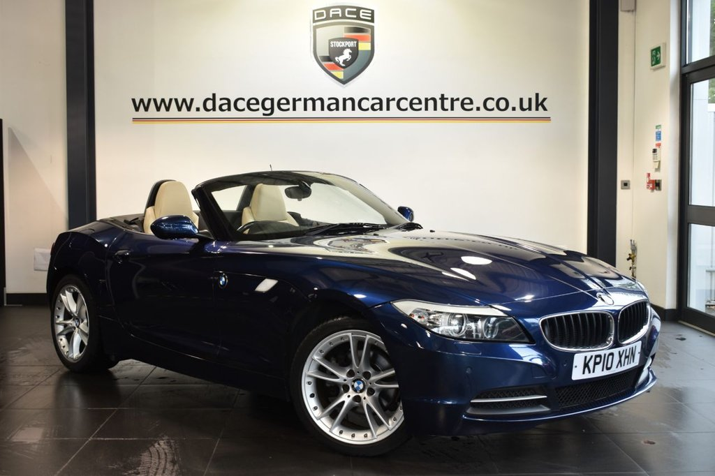 "USED 2010 10 BMW Z4 2.5 Z4 SDRIVE23I ROADSTER 2DR 201 BHP Finished in a stunning deep sea metallic blue styled with 18"" alloys. Upon opening the drivers door you are presented with full beige leather interior, full service history, bluetooth, heated sport seats, Multifunction steering wheel, Headlight cleaning system, Automatic air conditioning, parking sensors"