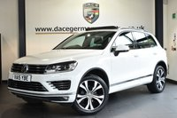 """USED 2015 15 VOLKSWAGEN TOUAREG 3.0 V6 R-LINE TDI BLUEMOTION TECHNOLOGY 5DR AUTO 259 BHP Finished in a stunning white styled with 20"""" alloys. Upon opening the drivers door you are presented with full leather interior, full service history, satellite navigation, full panoramic roof, bluetooth, heated sport seats, DAB radio, xenon lights, cruise control, heated multi functional steering wheel, heated electric folding mirrors, parking sensors"""