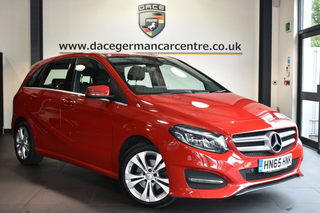 """USED 2015 65 MERCEDES-BENZ B-CLASS 2.1 B 200 D SPORT PREMIUM 5DR AUTO 134 BHP Finished in a stunning red styled with 17"""" alloys. Upon opening the drivers door you are presented with full black leather interior, full service history, satellite navigation, bluetooth, reversing camera, heated seats, cruise control, multi functional steering wheel, climate control, electric folding mirrors, parking sensors"""