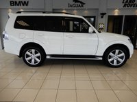 USED 2017 17 MITSUBISHI SHOGUN 3.2 DI-D SG4 5d AUTO 187 BHP FINISHED IN STUNNING FROST WHITE WITH CONTRASTING HEATED BLACK LEATHER SEATS + 1 OWNER FROM NEW + HUGE SPECIFICATION + SATELLITE NAVIGATION + PANORAMIC GLASS SUNROOF + BLUETOOTH PHONE AND BLUETOOTH MEDIA + DAB DIGITAL RADIO + REAR SEAT ENTERTAINMENT WITH HEADPHONES + PARKING SENSORS + CRUISE CONTROL + UNMARKED ALLOY WHEELS + REVERSE CAMERA + SIDE STEPS + HEATED ELECTRICALLY ADJUSTABLE FRONT SEATS + CLIMATE CONTROLLED DUAL ZONE AIRCONDITIONING + ELECTRIC MIRRORS AND WINDOWS + 7 SEATS + LOVINGLY C