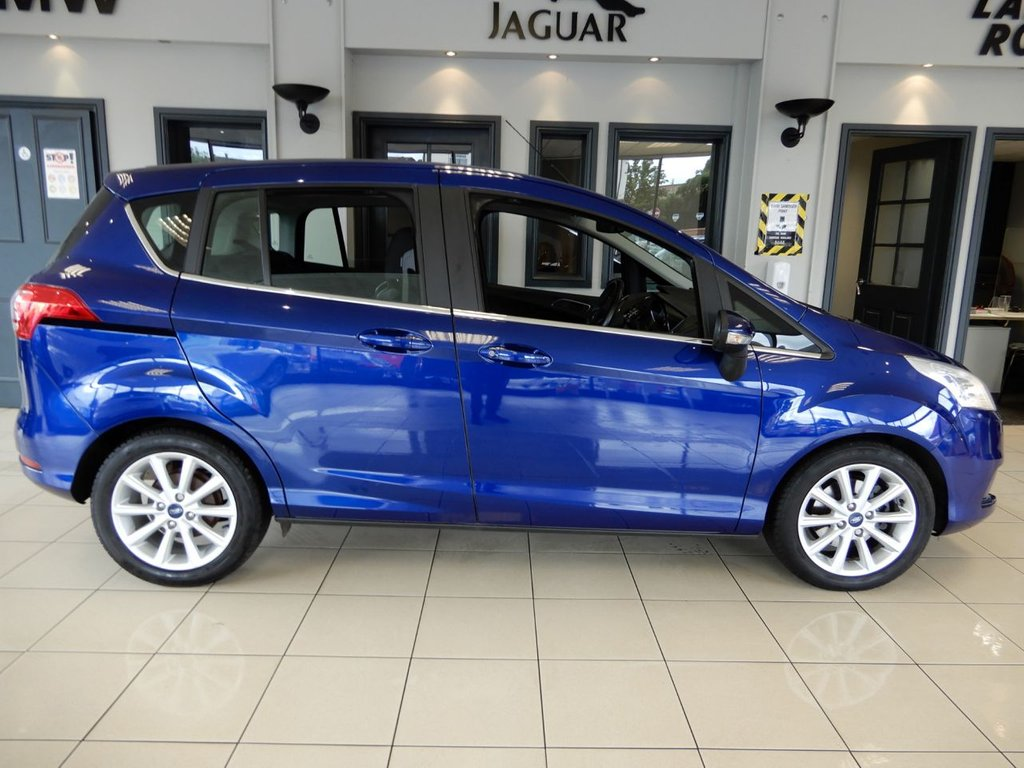 USED 2017 17 FORD B-MAX 1.6 TITANIUM NAVIGATOR 5d AUTO 104 BHP FINISHED IN A STUNNING DARK METALLIC BLUE WITH NICELY CONTRASTING DARK GREY CLOTH SEATS + SATELLITE NAVIGATION + IMMACULATE 1 OWNER CAR WITH A COMPREHENSIVE (3 SERVICES) FORD MAIN DEALER SERVICE HISTORY + BLUETOOTH PHONE CONNECTIVITY + BLUETOOTH MEDIA + HEATED FRONT SCREEN + PARKING SENSORS + MULTI FUNCTION STEERING WHEEL + CLIMATE CONTROLLED DUAL ZONE AIR CONDITIONING + HEIGHT ADJUSTABLE SEATS + FRONT AND REAR FOGLIGHTS + MEDIA DISPLAY SCREEN + 60/40 SPLIT FOLDING REAR SEATS + LOVELY CAR