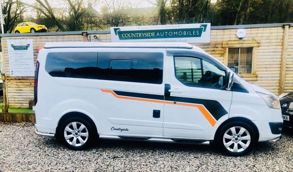 USED 2016 16 FORD TRANSIT CUSTOM 2.2 270 LIMITED LR P/V 124 BHP Professionally converted Cross stitched tri colour leather trim, Passenger seat swivels, the front  heated seats, Bluetooth, cruise, parking sensors, A.C., a remote-controlled rock and roll bed, USB ports throughout the interior, plenty of storage, 3 in 1 power fridge, cooker/ sink combo and a pop top roof that can give extra head room during the day and a double bed at night. The van has a quality German diesel heating system, dual leisure battery NOCO charging system with electric hook up.