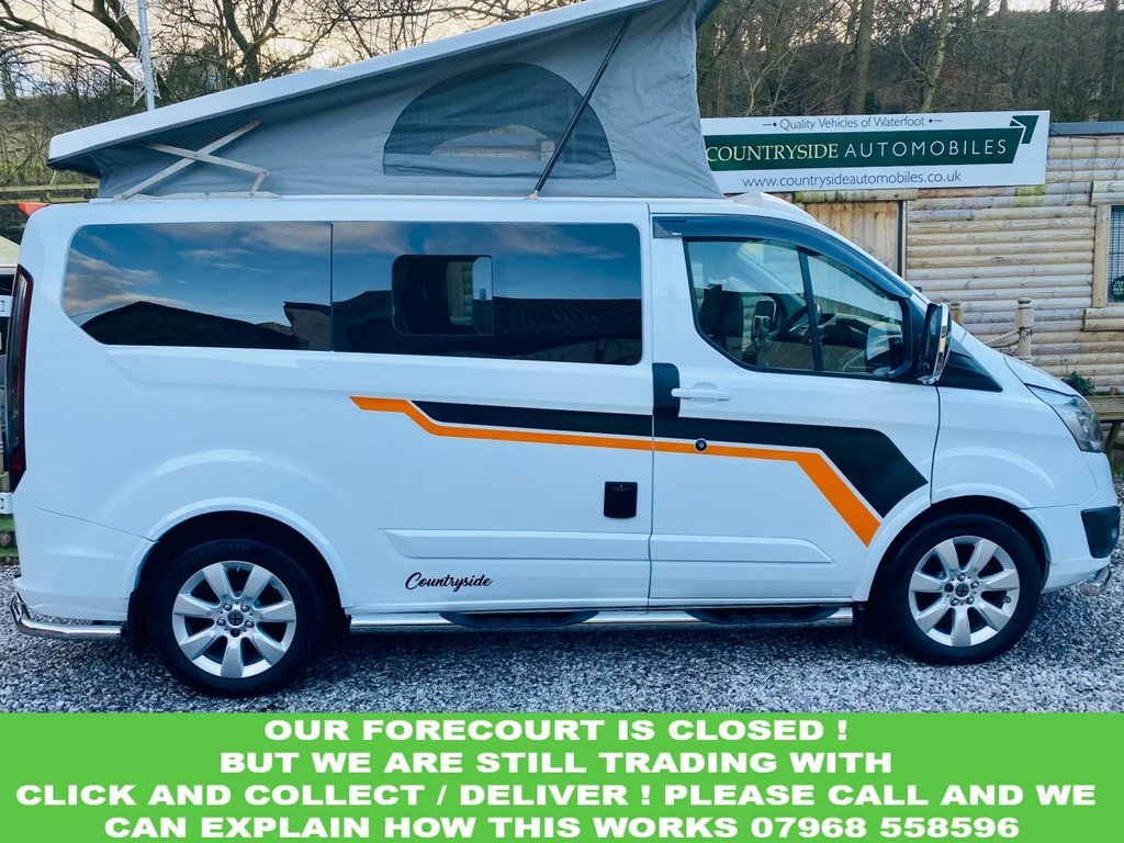 USED 2016 16 FORD TRANSIT CUSTOM 2.2 270 LIMITED LR P/V 124 BHP NEW Conversion, 54k, Great spec with A.C., Heated screen F + R  park sensors, Heated seats, FSH, Blue-tooth voice control. 17 In Alloys all new Michelin tyres! fitted with premium full side conversion which includes elevating roof, M1 Tested Electric remote rock and roll bed elevating roof board, Smev Sink, 2 burner hob, Dometic fridge, Autoterm 2KW heating, Full stunning upholstery re-trim.  Swivel seat M1 tested. LED lighting, USB and uk plug, Leisure battery, Split charging system, 240v hook