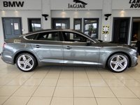 USED 2018 18 AUDI A5 2.0 SPORTBACK TDI S LINE 5d AUTO 148 BHP FINISHED IN A STUNNING METALLIC GREY AND COMPLIMENTED BY PART BLACK LEATHER HEATED SEATS + 1 OWNER FROM NEW WITH AN IMPECCABLE FULL AUDI MAIN DEALER SERVICE HISTORY + SATELLITE NAVIGATION + VOICE COMMAND + POWER FOLDING MIRRORS + FLAT BOTTOM SLINE STEERING WHEEL + LED DAY TIME RUNNING LIGHTS + CRUISE CONTROL + CLIMATE CONTROLLED DUAL ZONE AIR CONDITIONING + FRONT AND REAR FOGLIGHTS + PRIVACY GLASS + BLUETOOTH PHONE AND BLUETOOTH MEDIA + WIFI CONNECTIVITY + APPLE CARPLAY + DAB DIGITAL RADIO + ELE