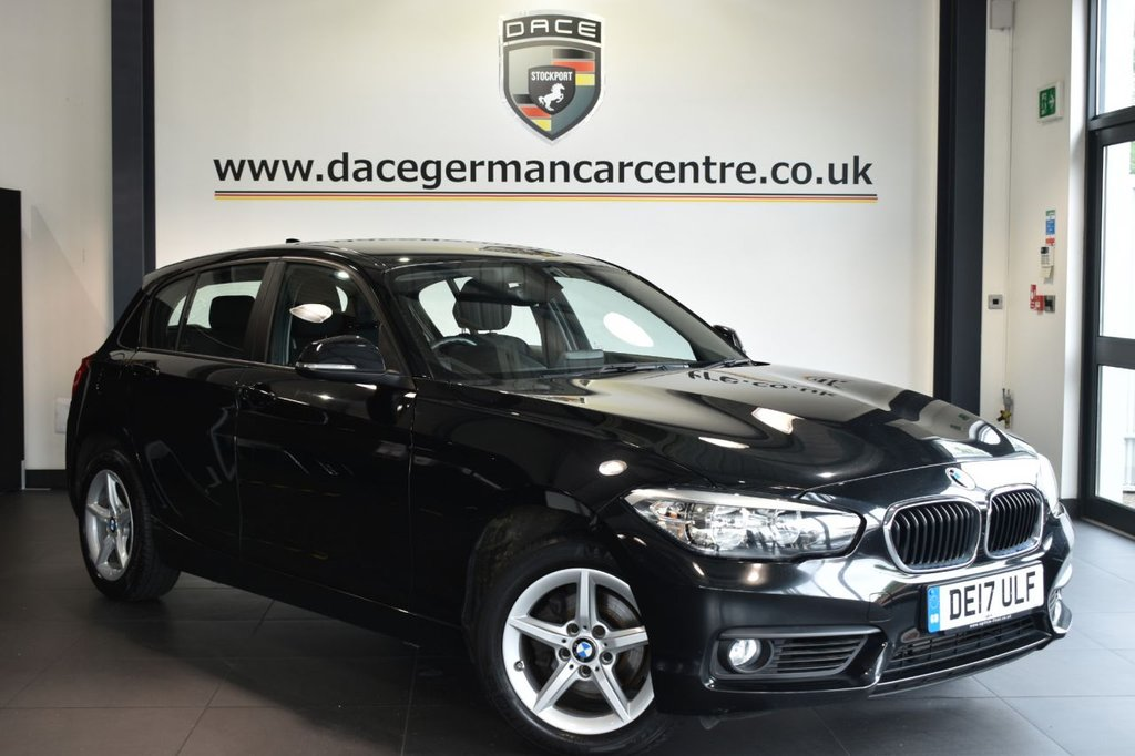 "USED 2017 17 BMW 1 SERIES 2.0 118D SE 5DR 147 BHP Finished in a stunning sapphire metallic black styled with 16"" alloys. Upon opening the drivers door you are presented with anthracite upholstery, full service history, satellite navigation, bluetooth, cruise control, DAB radio, Multifunction steering wheel, Connected Drive Services, rain sensors, parking sensors"