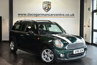 """USED 2011 61 MINI CLUBMAN 1.6 ONE 5DR 98 BHP Finished in a stunning british racing metallic green styled with 15"""" alloys. Upon opening the drivers door you are presented with carbon black upholstery, bluetooth, DAB radio, Multifunction steering wheel, Automatic air conditioning, On-board computer, Light package, Radio MINI Boost CD, parking sensors"""