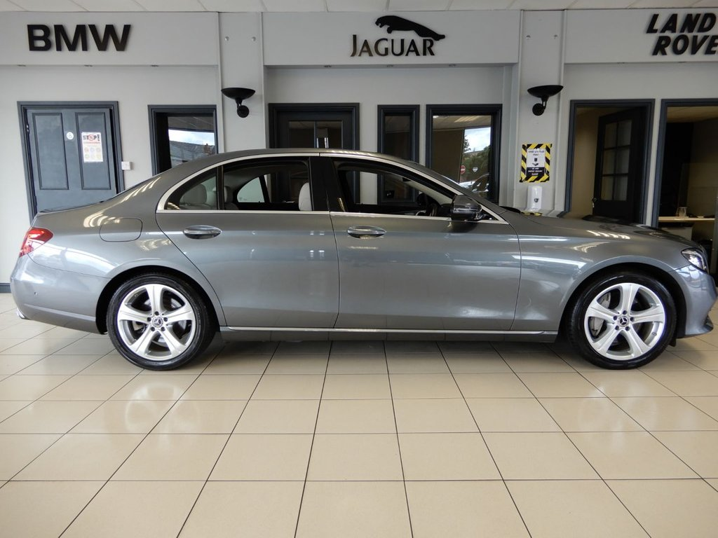 USED 2017 17 MERCEDES-BENZ E-CLASS 3.0 E 350 D SE 4d AUTO 255 BHP FINISHED IN STUNNING METALLIC GREY WITH FULL CREAM LEATHER HEATED ELECTRICALLY ADJUSTABLE SEATS AND BLACK CARPETTING + 1 OWNER FROM NEW WITH AN IMPECCABLE FULL MERCEDES MAIN DEALER SERVICE HISTORY + INCREDIBLY GOOD LOOKING E CLASS WITH THE MOST SOUGHT AFTER COLOUR COMBINATION AND THE BEST DRIVERS COCKPIT AVAILABLE ON A CAR TODAY + COMAND ONLINE WIDESCREEN FULL DIGITAL DASH + VIRTUAL COCKPIT + SATELLITE NAVIGATION + DAB DIGITAL RADIO + BLUETOOTH MEDIA + 360 DEGREE VIEW CAMERA + ACTIVE PARK ASSIST