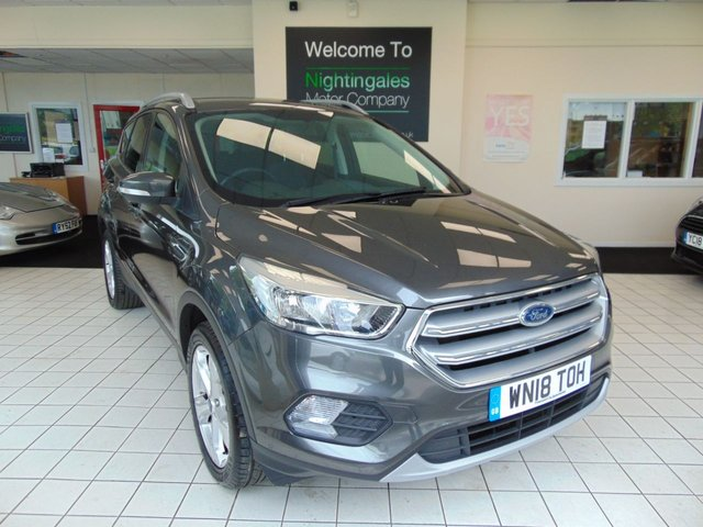 "USED 2018 18 FORD KUGA 1.5 ZETEC 5d 148 BHP FORD WARRANTY UNTIL MARCH 2021 + BLUETOOTH + CRUISE CONTROL + AIR CONDITIONING + ABS + DAB RADIO + QUICK CLEAR WINDSCREEN + REMOTE CENTRAL LOCKING + ELECTRIC WINDOWS + 18.5"" ALLOY WHEELS + SPARE WHEEL + APPEARANCE PACK + ISOFIX + DAYTIME RUNNING LIGHTS + THATCHAM CAT 1 ALARM + HILL START ASSIST + FRONT FOG LIGHTS + METALLIC PAINT"