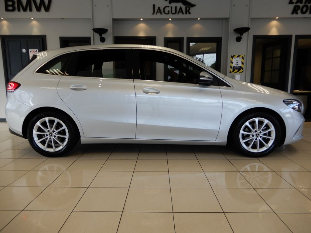 USED 2019 19 MERCEDES-BENZ B-CLASS 1.3 B 180 SPORT 5d AUTO 135 BHP FINISHED IN STUNNING METALLIC IRIDUM SILVER WITH PART CLOTH PART LEATHER SEATS + VIRTUAL COCKPIT + SATELLITE NAVIGATION + DAB DIGITAL RADIO + BLUETOOTH MEDIA WITH APPLE CARPLAY/ANDRIOD AUTO + COLLISON ASSIST + STUNNING CAR COMPLIMENTED BY AN INCREDIABLE DIGITAL DASH DISPLAY + AUTOMATIC CLIMATE CONTROL + DUAL ZONE AIR CONDITIONING + REAR CAMERA 180 view + AUTOMATIC ADAPTIVE HEADLIGHTS WITH LED DAYTIME RUNNING LIGHTS + SERVICE HISTORY + THIS STUNNING CAR COMES WITH THE BALANCE OF MERCEDES MANUFACT