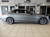 """USED 2019 19 MERCEDES-BENZ C-CLASS 1.5 C 200 AMG LINE PREMIUM 4d AUTO 181 BHP FINISHED IN STUNNING SELENITE GREY WITH FULL BLACK LEATHER HEATED SEATS WITH ELECTRIC ADJUSTMENT + BIG SCREEN SATELLITE NAVIGATION + DIGITAL DASH + APPLE CARPLAY + ANDROID AUTO + REAR CAMERA + STUNNING SURROUND AMBIENT LIGHTING PACKAGE + 18"""" UNMARKED DIAMOND CUT ALLOY WHEELS + HIGH GLOSS BLACK INTERIOR TRIM + 1 OWNER FROM NEW STUNNING CAR IN SHOWROOM CONDITION THROUGHOUT + COLLSION WARNING + REAR VIEW CAMERA + UNDER MANUFACTURER WARRANTY UNTIL 2022 + ULEZ COMPLAINT"""