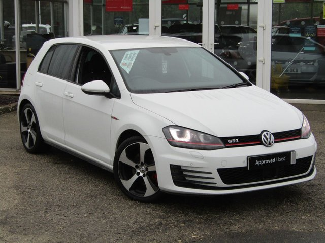 USED 2017 66 VOLKSWAGEN GOLF 2.0 GTI 5d 218 BHP Finished in PURE WHITE, with contrasting RETRO grey checked sports interior. This is a 1 owner classic HOT HATCH. Comes with LED run Lights, Convenience Pack, Heated Seats, SAT NAV, DAB, B/Tooth, Cruise, Power Folding Mirrors and Park Sensors. Performance as the name suggests is very lively and makes an Ideal quick Family Hatch. Dealer Serviced at 19170 miles, 29393 miles, 38957 miles and on arrival by EMC.
